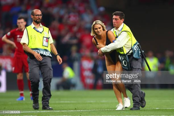 Pitch invader Kinsey Wolanski is removed by stewards during the UEFA Champions League Final between Tottenham Hotspur and Liverpool at Estadio Wanda...