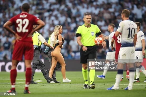 Pitch invader Kinsey Wolanski is removed during the UEFA Champions League Final between Tottenham Hotspur and Liverpool at Estadio Wanda...