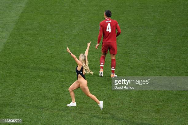 Pitch invader Kinsey Wolanski runs onto the field during the UEFA Champions League Final between Tottenham Hotspur and Liverpool at Estadio Wanda...