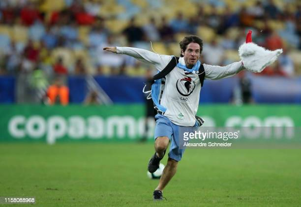 Pitch invader runs during the Copa America Brazil 2019 group C match between Chile and Uruguay at Maracana Stadium on June 24, 2019 in Rio de...