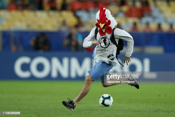 A pitch invader runs during the Copa America Brazil 2019 group C match between Chile and Uruguay at Maracana Stadium on June 24 2019 in Rio de...
