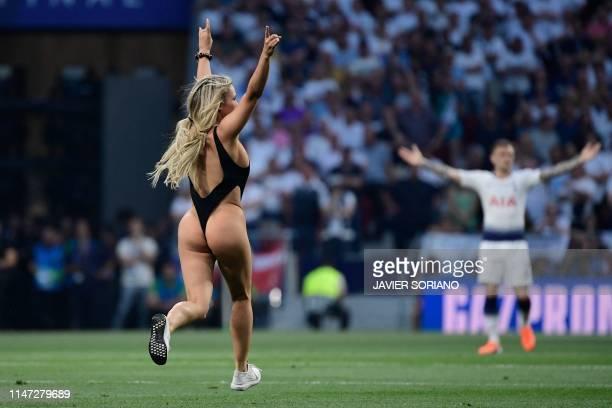 Pitch invader runs during the UEFA Champions League final football match between Liverpool and Tottenham Hotspur at the Wanda Metropolitan Stadium in...