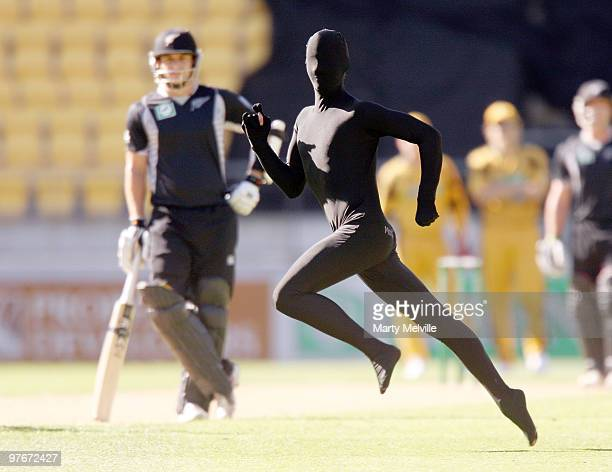 Pitch invader runs from security during the 5th ODI at Westpac Stadium on March 13, 2010 in Wellington, New Zealand.