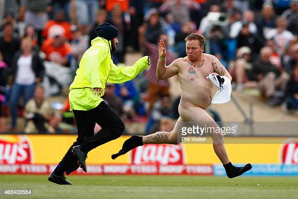 Pitch invader runs onto the field during the 2015 ICC Cricket World Cup match between Sri Lanka and New Zealand at Hagley Oval on February 14, 2015...
