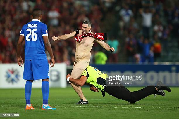 A pitch invader runs onto the field during the Asian Champions League final match between the Western Sydney Wanderers and Al Hilal at Pirtek Stadium...