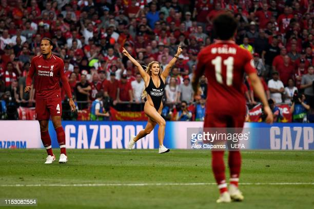 Pitch invader runs onto the field during the UEFA Champions League Final between Tottenham Hotspur and Liverpool at Estadio Wanda Metropolitano on...