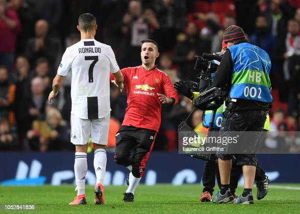 Pitch invader speaks to Cristiano Ronaldo of Juventus after the Group H match of the UEFA Champions League between Manchester United and Juventus at...