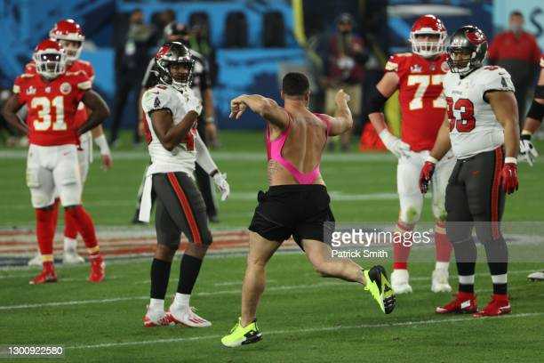 Pitch invader takes the field during the fourth quarter in Super Bowl LV between the Tampa Bay Buccaneers and the Kansas City Chiefs at Raymond James...