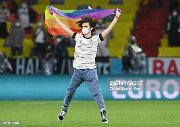 Pitch invader with a rainbow flag is seen on the pitch prior to the UEFA Euro 2020 Championship Group F match between Germany and Hungary at Allianz...