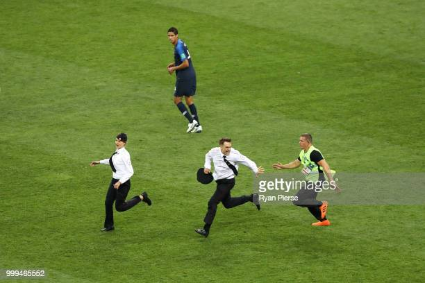 Pitch invaders are chased by the security staff during the 2018 FIFA World Cup Final between France and Croatia at Luzhniki Stadium on July 15 2018...