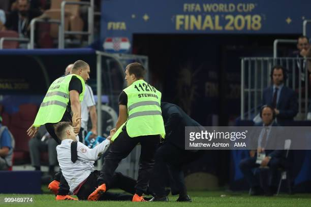 Pitch invaders during the 2018 World Cup Final during the 2018 FIFA World Cup Russia Final between France and Croatia at Luzhniki Stadium on July 15...