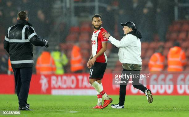 A pitch invador runs to Ryan Bertrand of Southampton after the Premier League match between Southampton and Crystal Palace at St Mary's Stadium on...