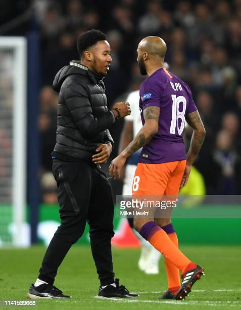 Pitch invador speaks to Fabian Delph of Manchester City during the UEFA Champions League Quarter Final first leg match between Tottenham Hotspur and...
