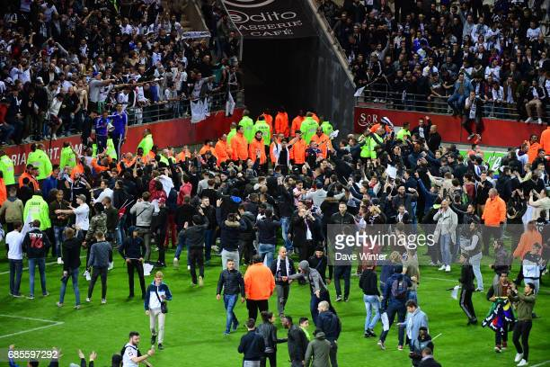 Pitch invasion as Amiens are promoted following the Ligue 2 match between Stade de Reims and Amiens SC at Stade Auguste Delaune on May 18 2017 in...