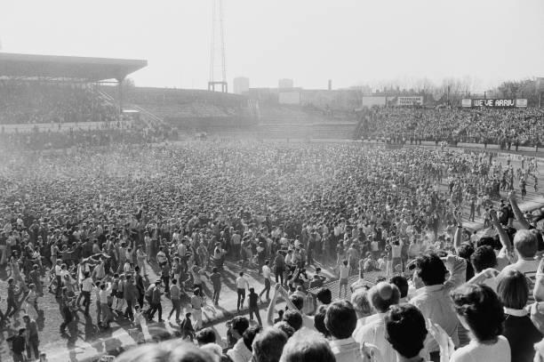 Pitch invasion during soccer match Chelsea v Leeds United at Stamford Bridge, London, UK, 28th April 1984.