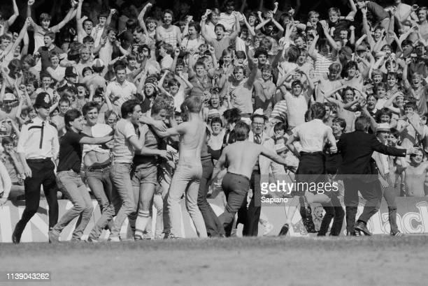 Pitch invasion during soccer match Chelsea v Leeds United at Stamford Bridge London UK 28th April 1984