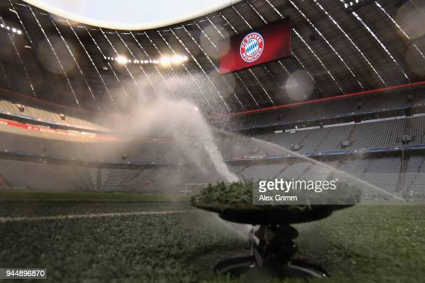 Pitch watering prior to the UEFA Champions League Quarter Final Second Leg between FC Bayern Muenchen and Sevilla FC at Allianz Arena on April 11,...
