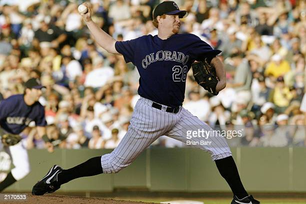 Pitcher Aaron Cook of the Colorado Rockies delivers against the San Francisco Giants during the MLB game at Coors Field on July 9 2003 in Denver...