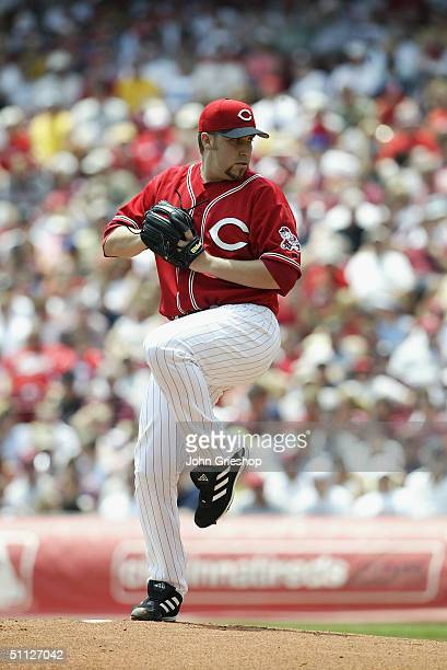 Pitcher Aaron Harang of the Cincinnati Reds winds up to deliver the ball during MLB game against the Cleveland Indians at Great American Ball Park on...