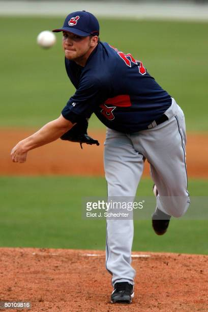 Pitcher Aaron Laffey of the Cleveland Indians delivers a pitch against the Cincinnati Reds during a Spring Training game at Ed Smith Stadium on March...