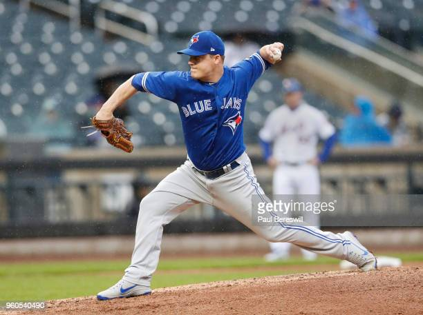 Pitcher Aaron Loup of the Toronto Blue Jays pitches during a interleague MLB baseball game against the New York Mets on May 16 2018 at CitiField in...