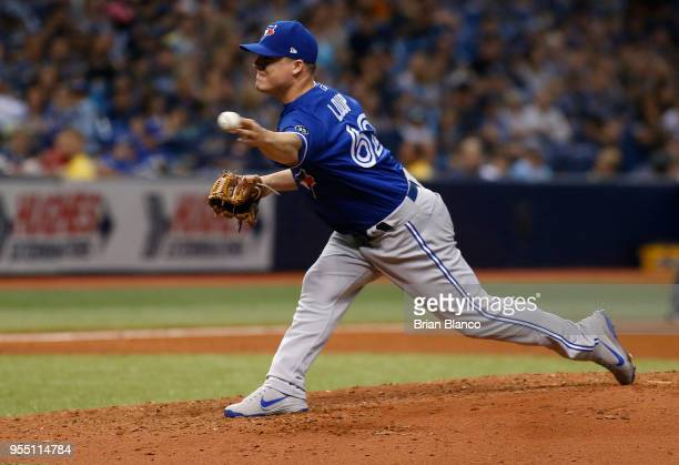 Pitcher Aaron Loup of the Toronto Blue Jays pitches during the fourth inning of a game against the Tampa Bay Rays on May 5 2018 at Tropicana Field in...