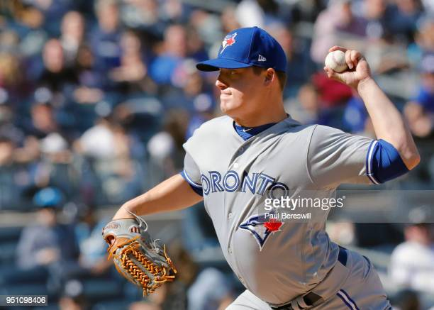 Pitcher Aaron Loup of the Toronto Blue Jays pitches in an MLB baseball game against the New York Yankees on April 21 2018 at Yankee Stadium in the...