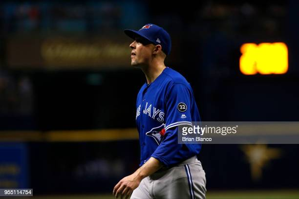 Pitcher Aaron Sanchez of the Toronto Blue Jays makes his way to the dugout after being taken off of the mound by manager John Gibbons during the...
