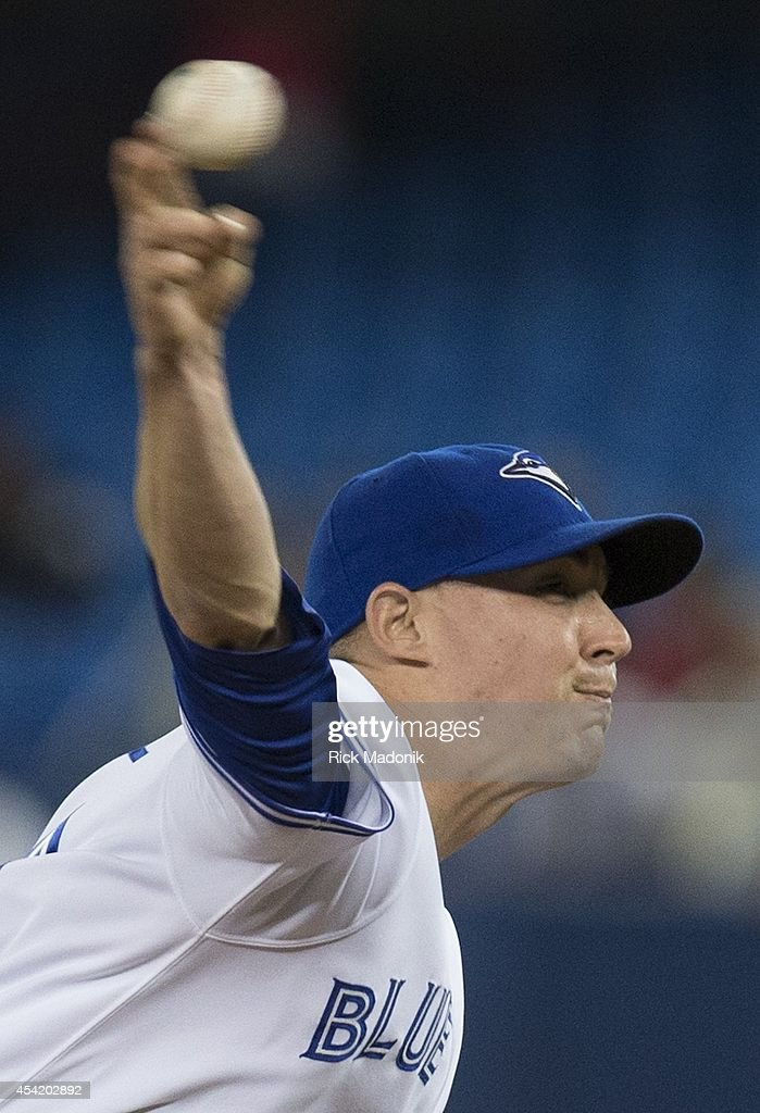 TORONTO - AUGUST 25 - Pitcher Aaron Sanchez pitches in the 10th inning. Toronto Blue Jays Vs Boston Red Sox during MLB action at Rogers Centre on August 25, 2014. Jays lost 4-3 in 10 innings.