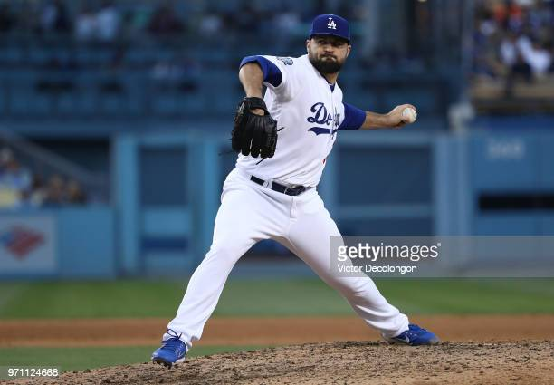 Pitcher Adam Liberatore of the Los Angeles Dodgers pitches in the seventh inning during the MLB game against the Miami Marlins at Dodger Stadium on...