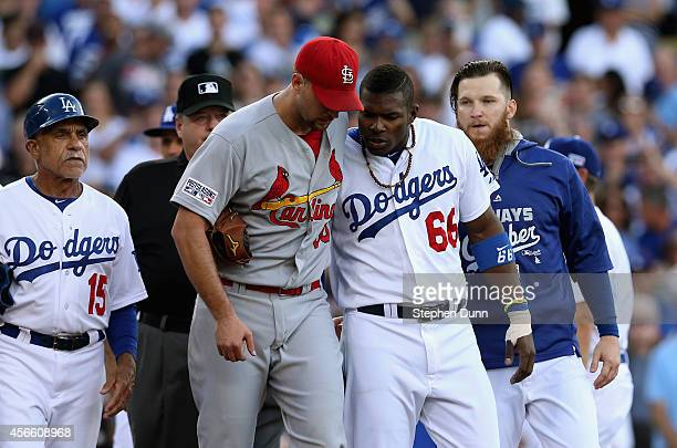 Pitcher Adam Wainwright of the St Louis Cardinals and Yasiel Puig of the Los Angeles Dodgers have a word after Puig was hit a by a pitch in the third...