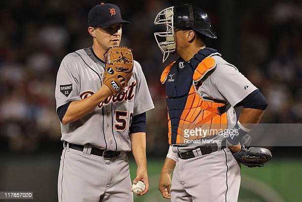 Pitcher Adam Wilk with Victor Martinez of the Detroit Tigers at Rangers Ballpark in Arlington on June 8 2011 in Arlington Texas