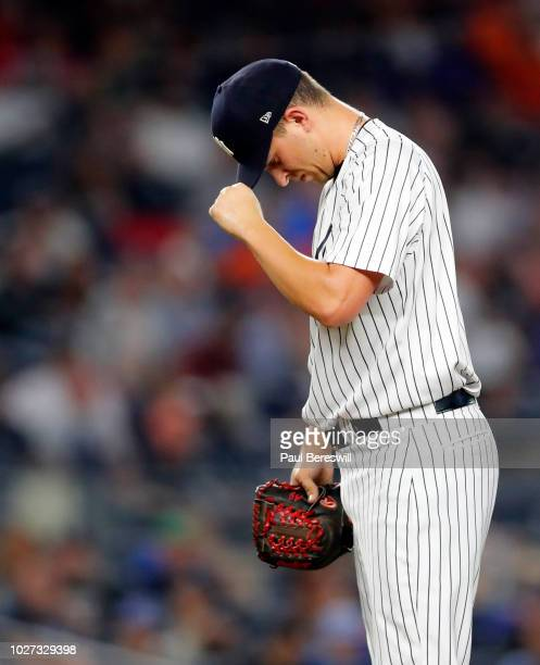 Pitcher AJ Cole of the New York Yankees reacts during an interleague MLB baseball game against the New York Mets on August 13 2018 at Yankee Stadium...