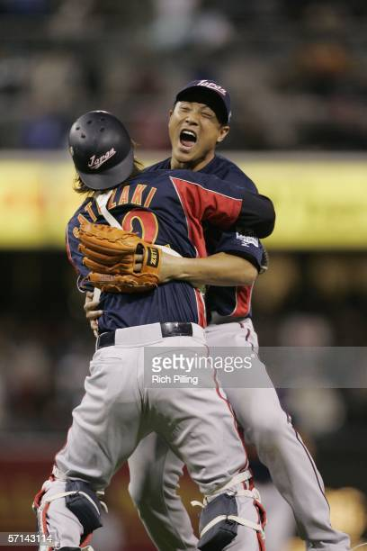 Pitcher Akinori Otsuka and catcher Tomoya Satozaki of Japan Celebrate winning the World Baseball Classic Championship Game against Cuba at PETCO Park...