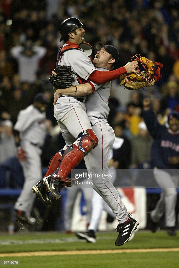 Pitcher Alan Embree and catcher Jason Varitek of the Boston Red Sox celebrate after winning game seven of the ALCS against the New York Yankees at Yankee Stadium on October 20, 2004 in the Bronx, New York. The Red Sox defeated the Yankees 10-3 to win the series four games to three.