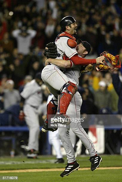 Pitcher Alan Embree and catcher Jason Varitek of the Boston Red Sox celebrate after winning game seven of the ALCS against the New York Yankees at...
