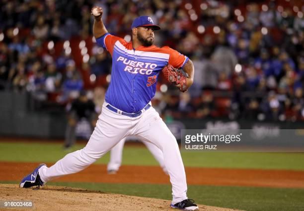 Pitcher Alberto Flores of Criollos de Caguas of Puerto Rico throws the ball during the final of Caribbean Baseball Serie against Aguilas Cibaenas of...
