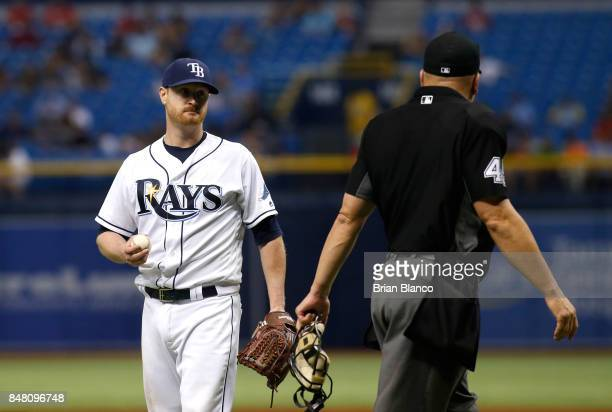 Pitcher Alex Cobb of the Tampa Bay Rays comes in to speak with home plate umpire Jeff Nelson after Nelson sent Andrew Benintendi of the Boston Red...