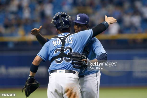 Pitcher Alex Colome of the Tampa Bay Rays hugs catcher Derek Norris following the Rays' 73 win over the New York Yankees at the conclusion of the...