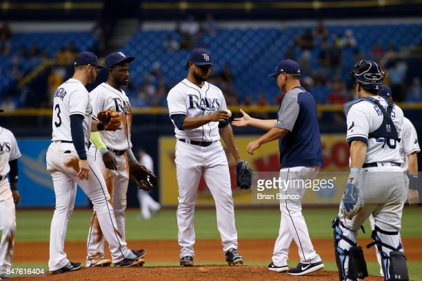 Pitcher Alex Colome of the Tampa Bay Rays is taken off the mound by manager Kevin Cash during the ninth inning of a game against the Boston Red Sox...