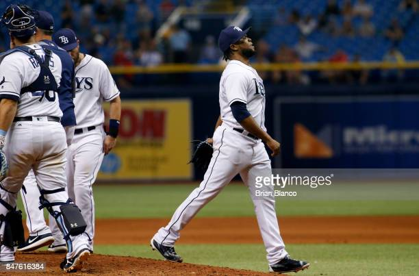 Pitcher Alex Colome of the Tampa Bay Rays makes his way to the dugout after being taken off the mound by manager Kevin Cash during the ninth inning...