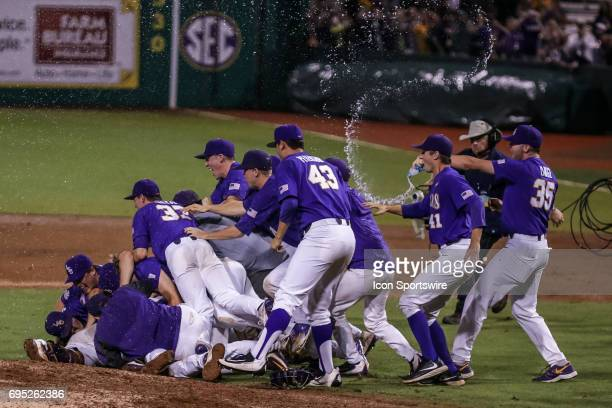 LSU pitcher Alex Lange throws water on the LSU dog pile after the Baton Rouge Division I Super Regional game between Mississippi St and LSU on June...