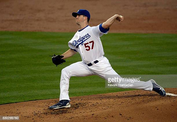 Pitcher Alex Wood of the Los Angeles Dodgers throws against New York Mets during the second inning of the baseball game at Dodger Stadium May 10 in...