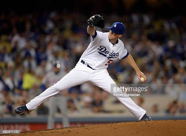 Pitcher Alex Wood of the Los Angeles Dodgers throws against New York Mets during the third inning of the baseball game at Dodger Stadium May 10 in...