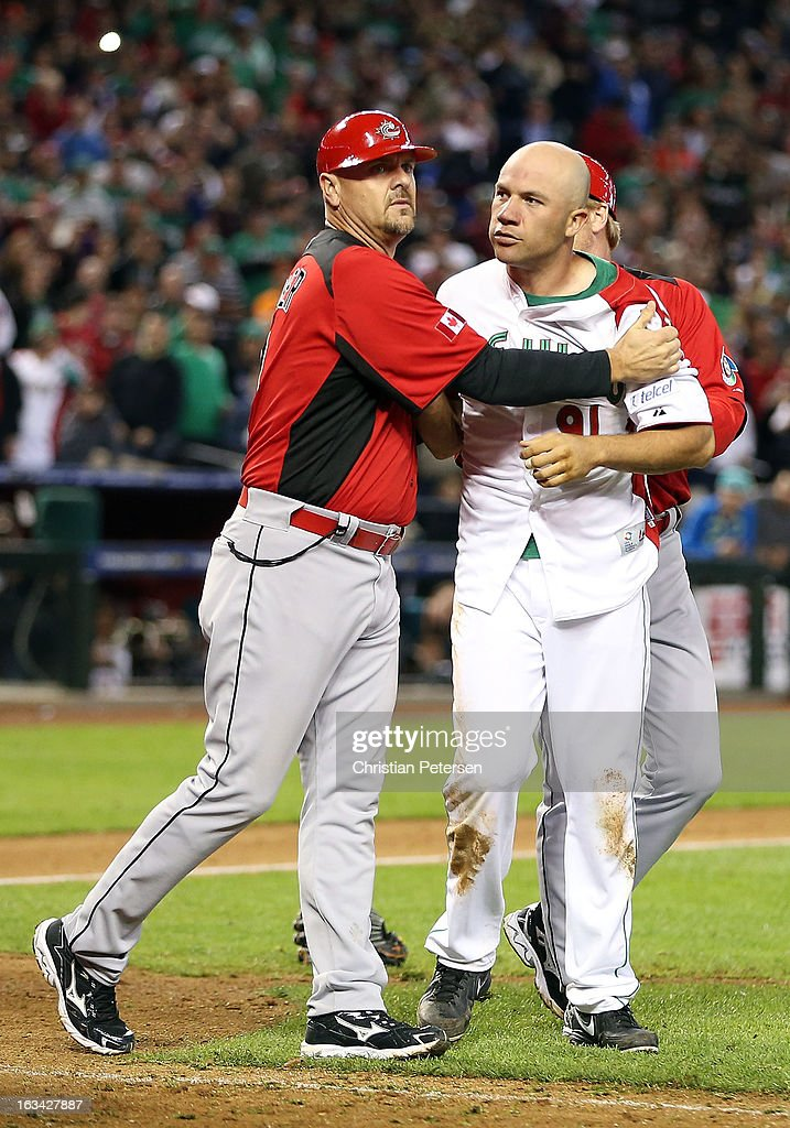 Pitcher Alfredo Aceves #91 of Mexico is held back by coach Larry Walker of Canada during an on field altercation between both teams in the World Baseball Classic First Round Group D game at Chase Field on March 9, 2013 in Phoenix, Arizona. Canada defeated Mexico 10-3.