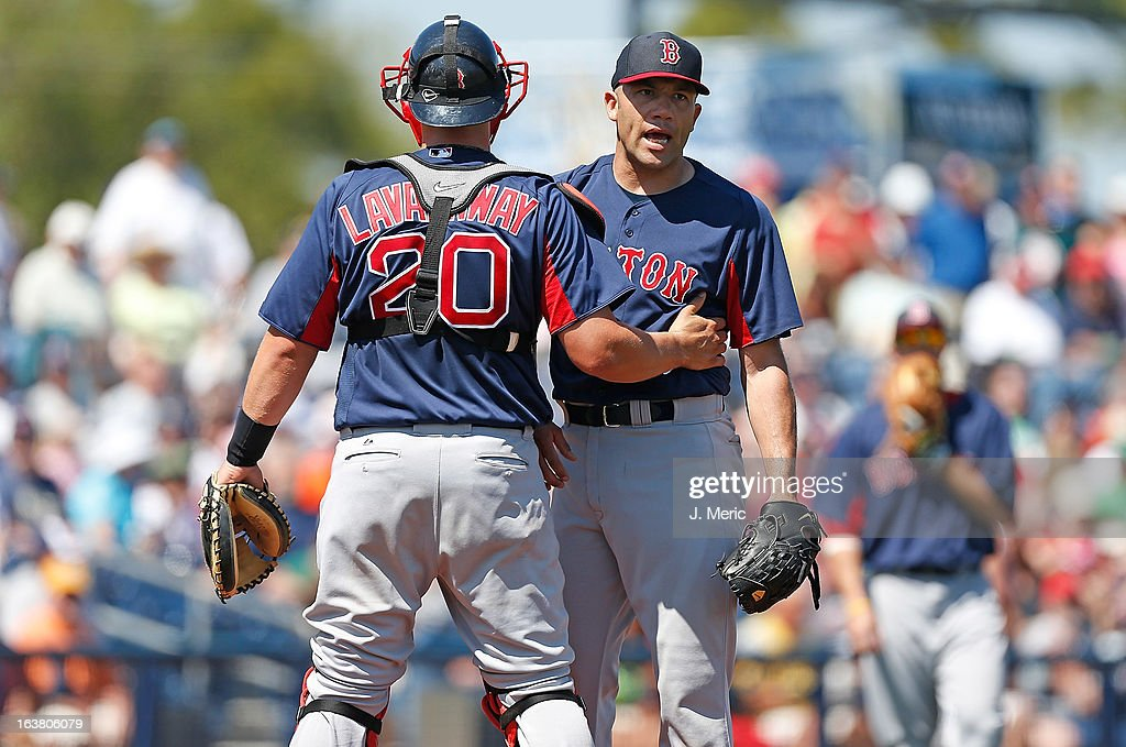 Pitcher Alfredo Aceves #91 of the Boston Red Sox is restrained by catcher Ryan Lavarnway #20 during a Grapefruit League Spring Training Game against the Tampa Bay Rays at the Charlotte Sports Complex on March 16, 2013 in Port Charlotte, Florida.