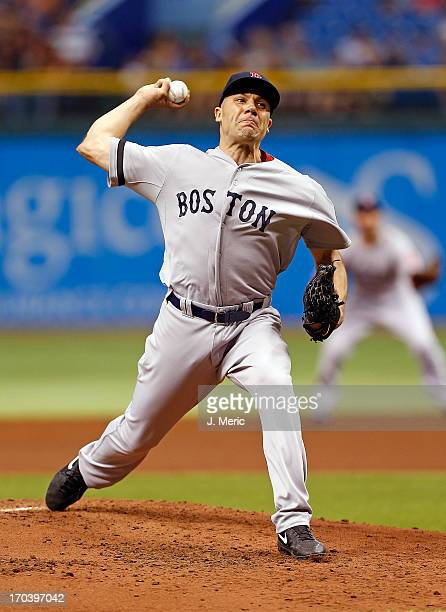 Pitcher Alfredo Aceves of the Boston Red Sox pitches against the Tampa Bay Rays during the game at Tropicana Field on June 12 2013 in St Petersburg...