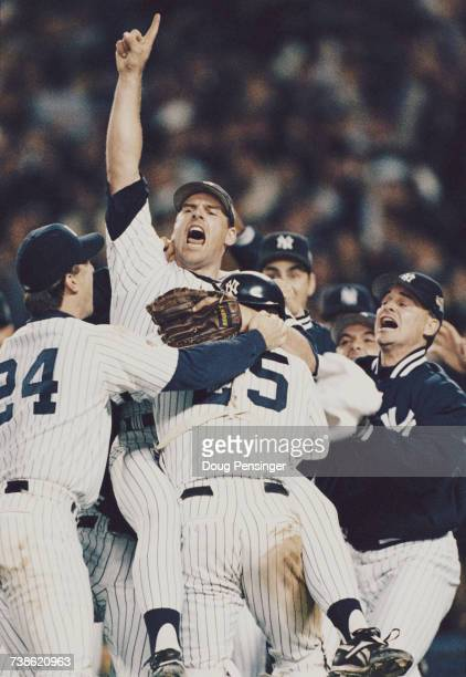 Pitcher and closer John Wetteland of the New York Yankees celebrates with his team mates after winning Game Six of the Major League Baseball World...