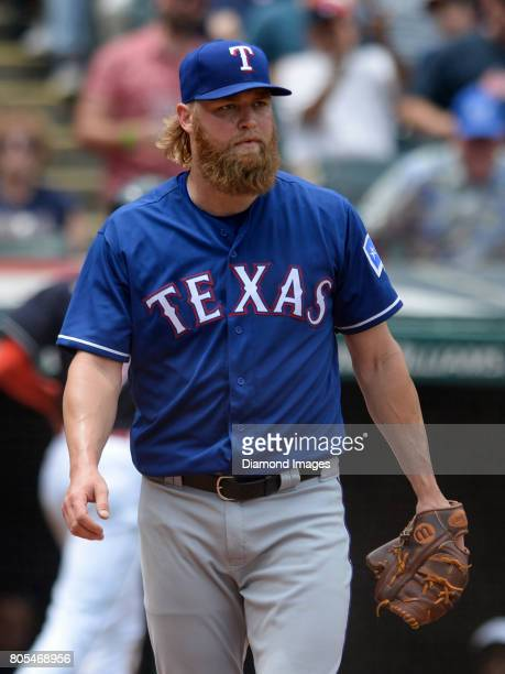 Pitcher Andrew Cashner of the Texas Rangers walks toward the pitcher's mound after centerfielder Bradley Zimmer of the Cleveland Indians scores a run...