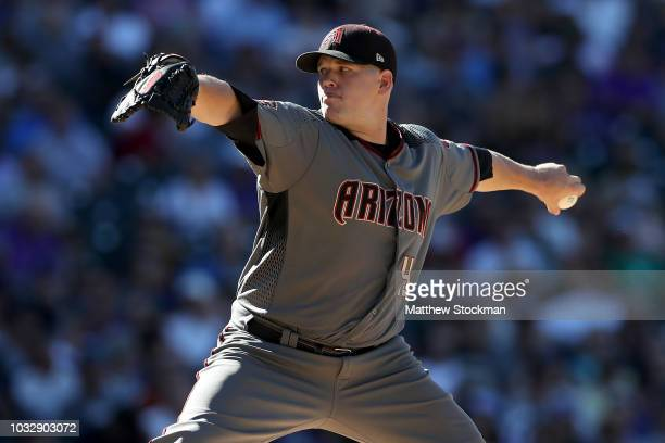 Pitcher Andrew Chafin of the Arizona Diamondbacks throws in the seventh inning against the Colorado Rockies at Coors Field on September 13 2018 in...